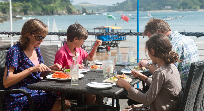 Family dining by the sea at the Beachside Restaurant, Salcombe
